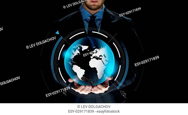 business, virtual reality, people and future technology concept - close up of businessman in suit with earth projection on hand over dark background