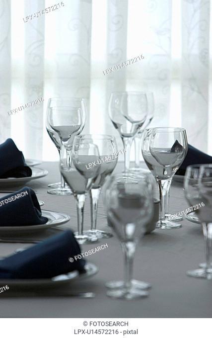 cup, glasses, dining, plates, napkins, arrangement