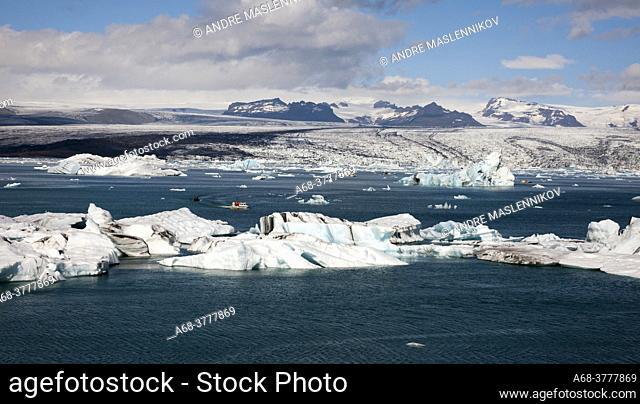 ceberg at Jökulsárlón on Breidamerkursandur. Thousands of people come here every day to see how the glacier tongue calves large icebergs