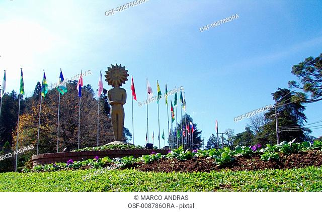 gramado rs flags on a square park with the kikito sungod