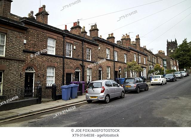 terrace of brick houses with stone dressings and slate rooves on church road woolton Liverpool Merseyside England UK