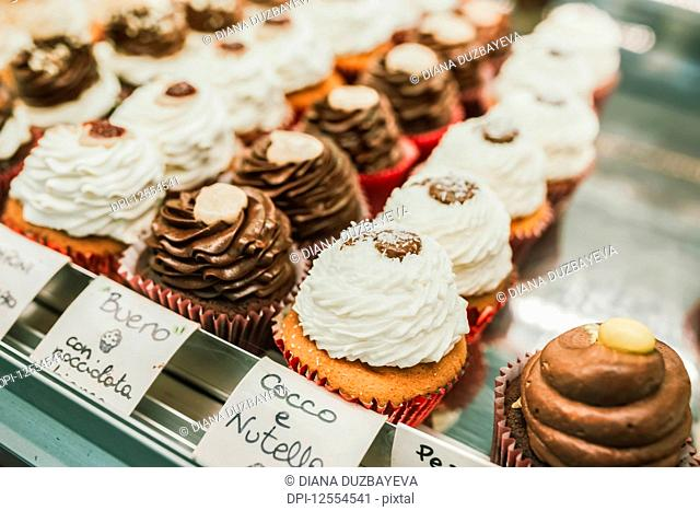 Baked goods on display in an Italian bakery; Italy
