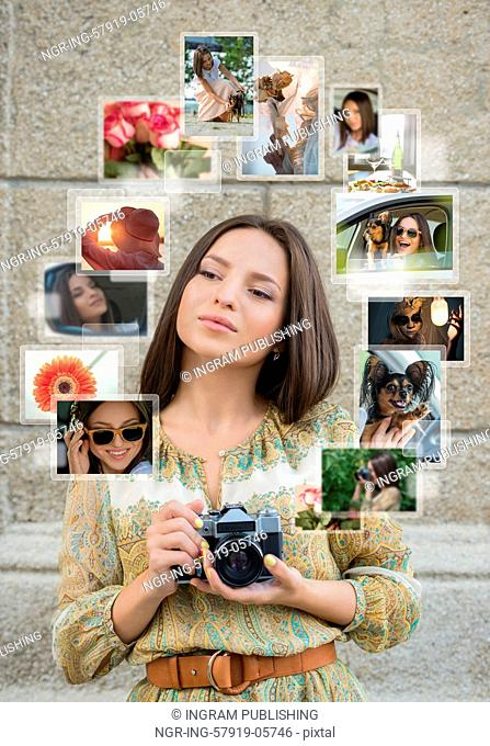 Young girl with retro camera and many images around her. Sharing photo in social media network concept