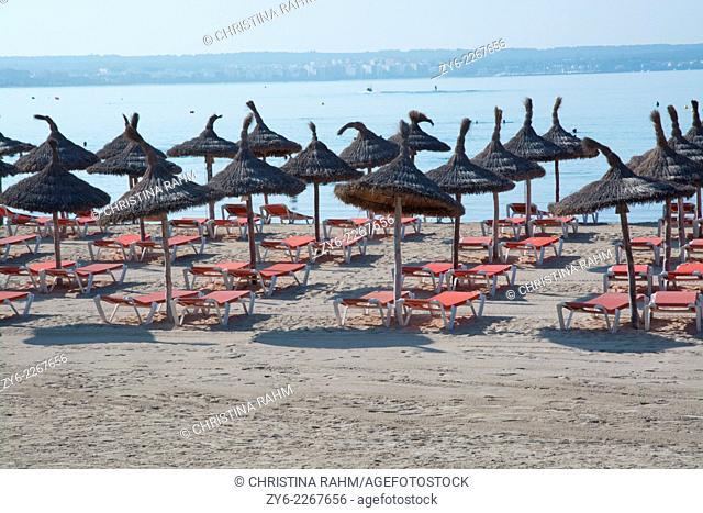 Straw parasols in Can Pastilla, Mallorca, Balearic islands, Spain in July