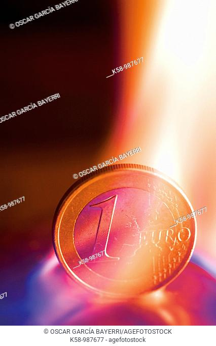 Euro currency between a flame