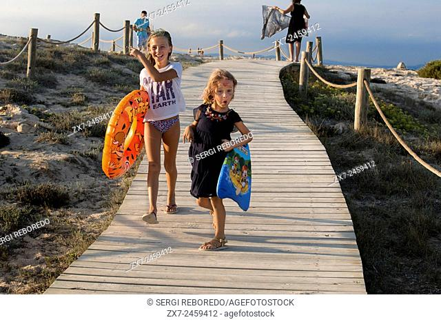 Sa Roqueta Beach and Ses Illetes Beach, Balearic Islands, Formentera, Spain. Funy girls with floats