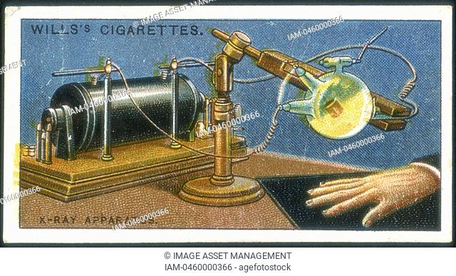X-ray apparatus powered by a Ruhmkorff coil being used to take an X-ray of a hand  Card published 1915  Chromolithograph
