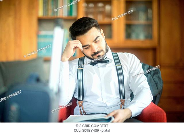 Businessman reading report