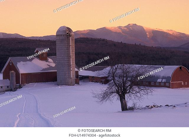 farm, winter scene, Mount Manfield, sunset, Vermont, Mt. Mansfield can be seen in the distance from the red barn on Tinker Farm at sunset in Fletcher in...