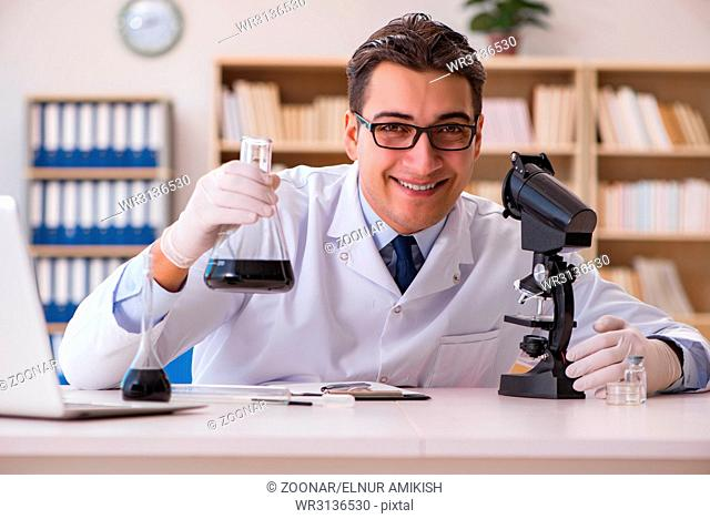 Young lab assistan working in the laboratory