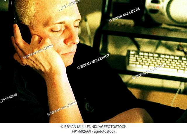 Man listening to music downloaded to computer