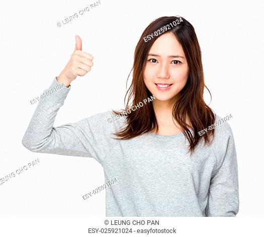 Asian woman showing thumb up