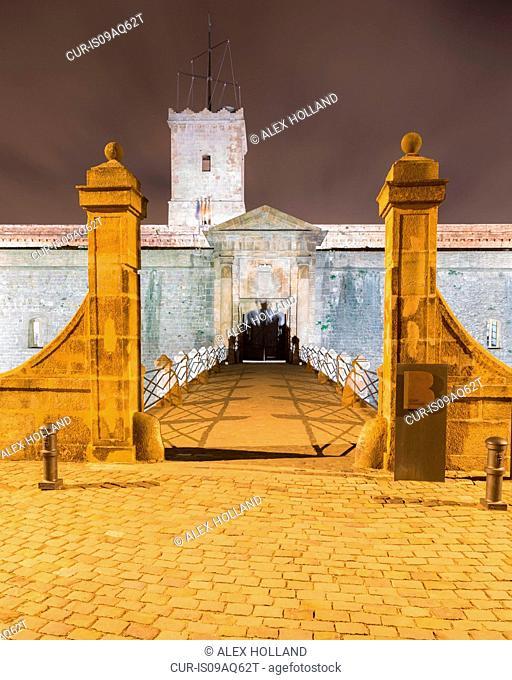 Entrance bridge of Montjuic Castle at night, Barcelona, Catalonia, Spain