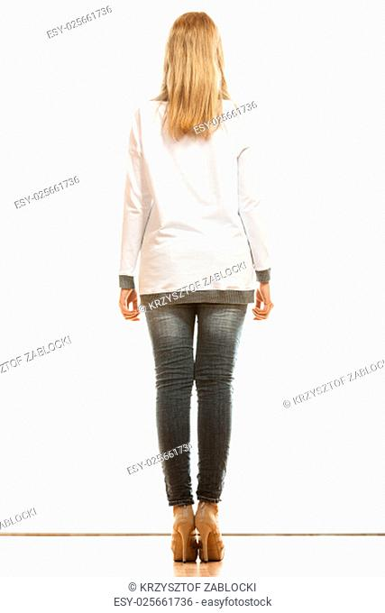 fashion and people concept. woman in full length denim trousers high heels shoes casual styles of blank white blouse back view isolated on white background
