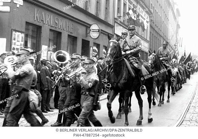 Nuremberg Rally 1933 in Nuremberg, Germany - Members of the SA (Sturmabteilung) march through the streets of Nuremberg. (Flaws in quality due to the historic...