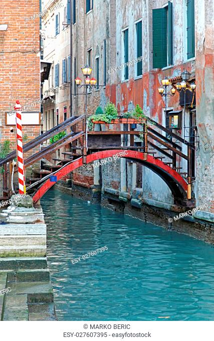 Wooden Bridge Over Small Canal in Venice