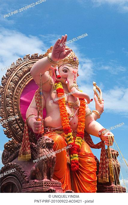 Low angle view of idol of Lord Ganesha, Mumbai, Maharashtra, India