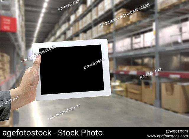 Abstrast Blurred background : Warehouse cargo with digital tablet