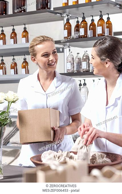 Two shop assistants working in wellness shop