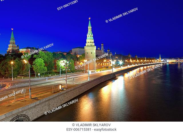 Kremlin embankment of the Moskva River and the Vodovzvodnaya (Water) Tower of the Moscow Kremlin at night. Shot from the Big Stone Bridge