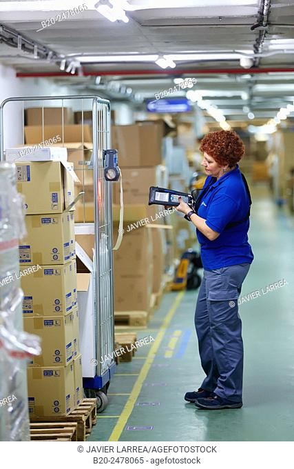 Woman with bar codes reader in hospital warehouse, Hospital Donostia, San Sebastian, Basque Country, Spain