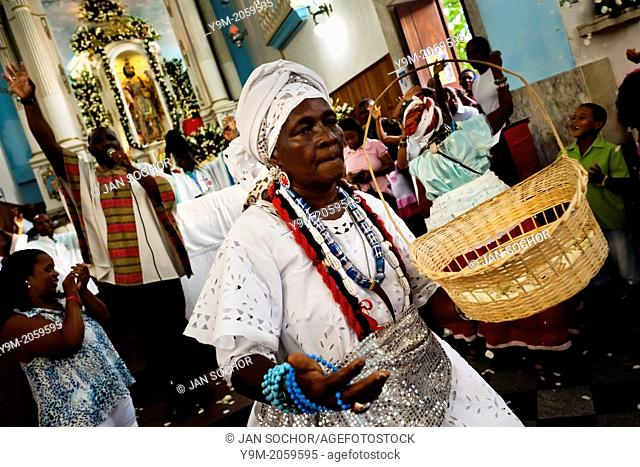 A Baiana woman performs the ritual dance in honor to Omolú, the Candomblé spirit syncretized with Saint Lazarus, inside the St