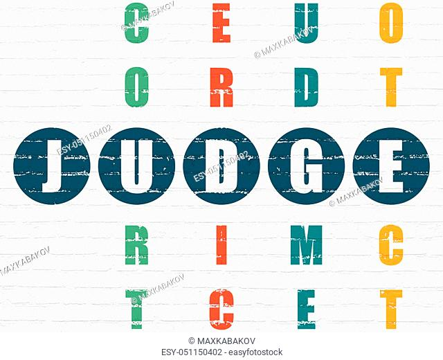 Law concept: Painted blue word Judge in solving Crossword Puzzle