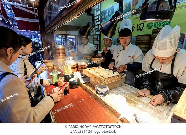 Shanghai, China - March 2, 2017: Chinese restaurant in the City Temple of Shanghai preparing steamed Xiao Long Bao