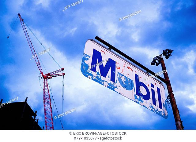 A construction crane is seen behind an old Mobil gas sign, Williamsburg, Brooklyn