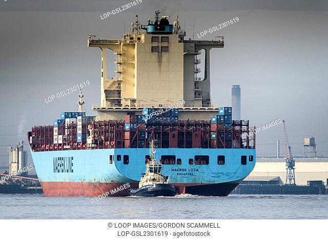 The container ship Maersk Lota about to enter Tilbury Port on the River Thames