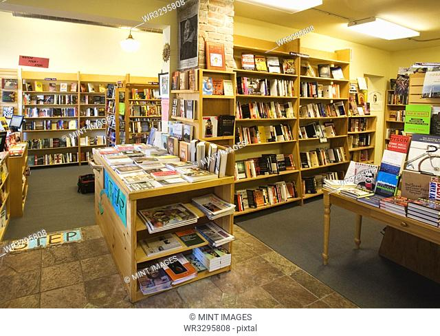Books on shelves and tables in bookstore