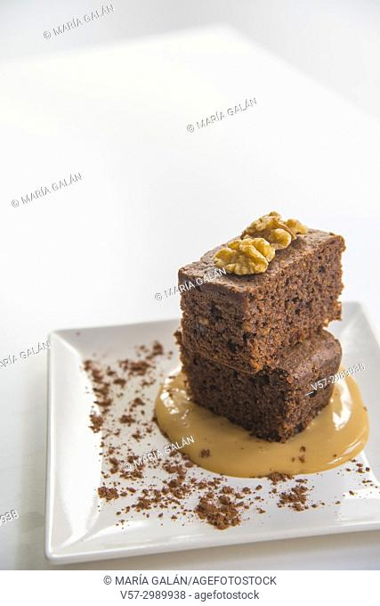 Chocolate cake with nuts and toffee sauce