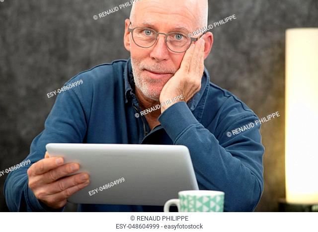 handsome senior man using a tablet computer