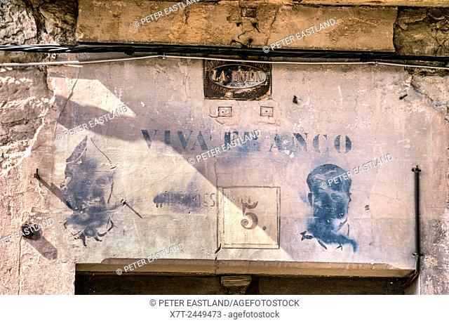 Old Franco propaganda above a doorway in, Ayerbe, Huesca Province, Northern Spain