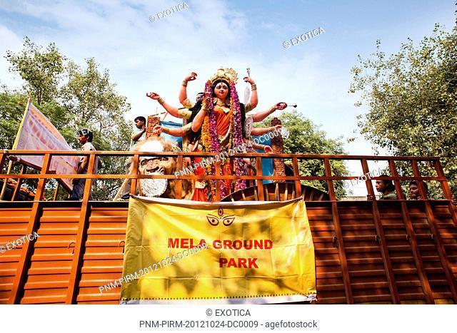 Statue of goddess Durga at a religious procession, Delhi, India