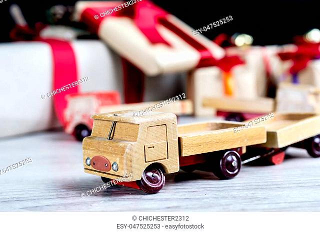 Close up of a vintage wooden truck with presents in the background