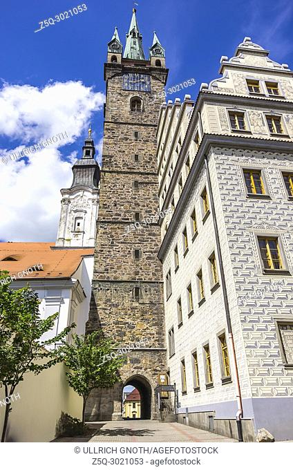 Klatovy, Czech Republic - Southside view of Jesuit Church of Immaculate Conception of the Virgin Mary and St. Ignatius, Black Tower and Old Town Hall