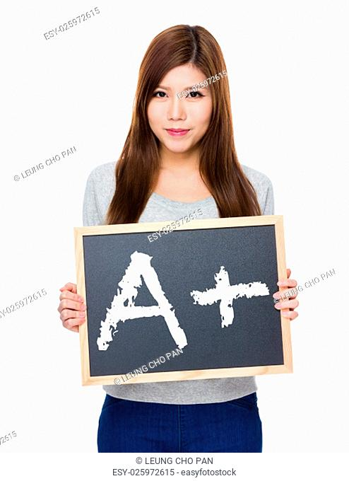 Asian woman hold with blackboard showing a A plus mark