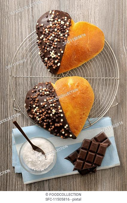 Brioche hearts with chocolate glaze and chocolate sprinkles for Valentine's Day