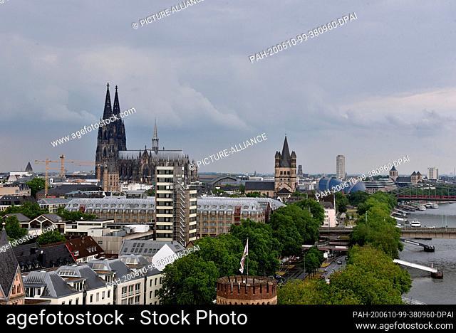 10 June 2020, North Rhine-Westphalia, Cologne: View of Rheinauhafen with Malakoffturm, Rhine, old town and Cologne Cathedral Photo: Horst Galuschka/dpa