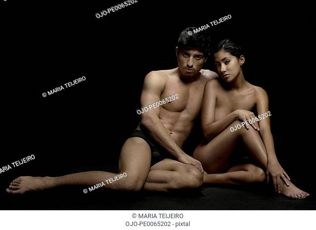Nude couple sitting together