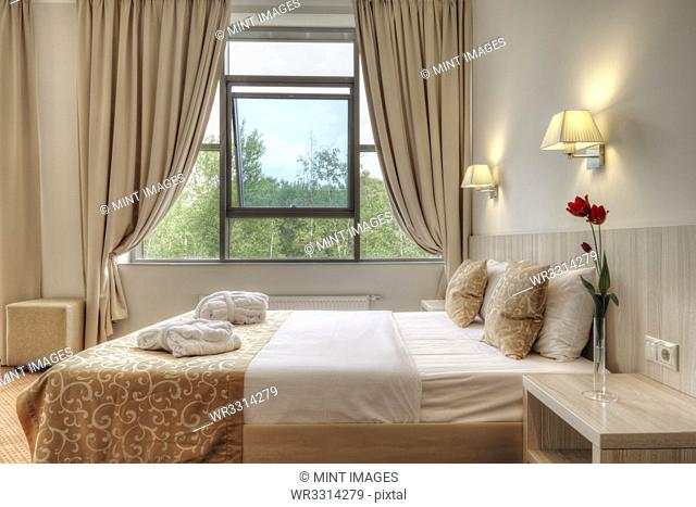Bed and curtains in hotel room