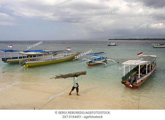 Scenic Landscape. Sunset at Gili Meno Island. Lombok, Indonesia. Some boats on the shore of the beach in the eastern part of the island