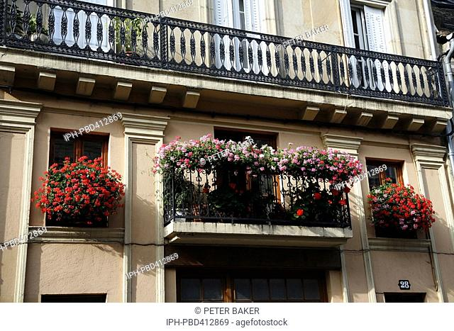 Flower filled balcony in the Burgundy town of Autun
