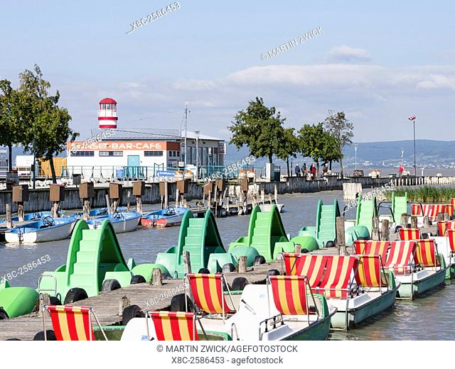 Podersdorf am See on the shore of Lake Neusiedl. The domestic port with small paddleboats at the jetty. The landscape around the lake is an UNESCO World...