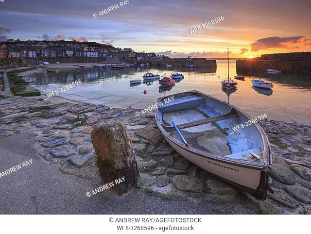 Boats at picturesque Mousehole harbour, in the west of Cornwall. Captured from the harbour side, at sunrise in late April