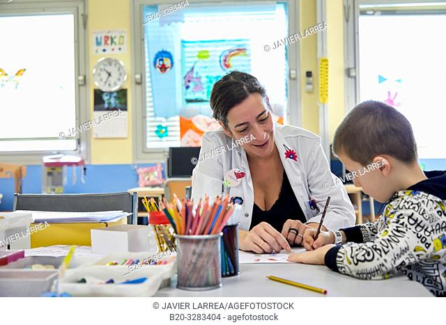 Teacher with children in a classroom of studies and games, Plant for hospitalization of children, Pediatrics, Medical care, Hospital Donostia, San Sebastian