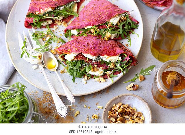 Crepes (with beetroot juice) with arugula nad feta
