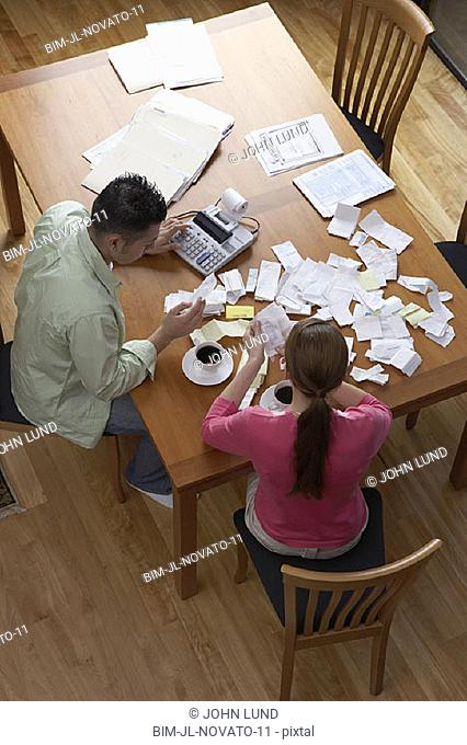 Couple sorting receipts