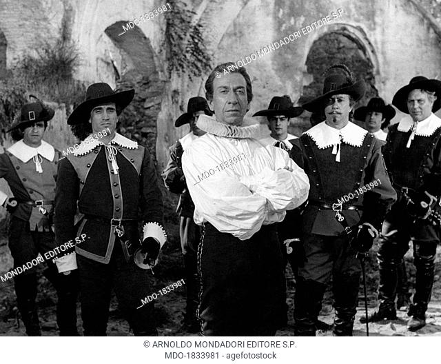 Puertorican-born American actor José Ferrer as Cyrano de Bergerac poses on the set of Abel Gance's Cyrano and d'Artagnan with actors and extras